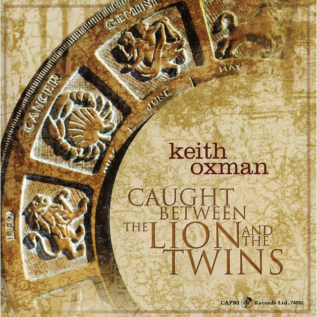 Keith Oxman CAUGHT BETWEEN THE LION & THE TWINS CD